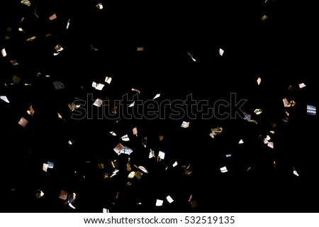 Golden confetti isolated on black background #532519135