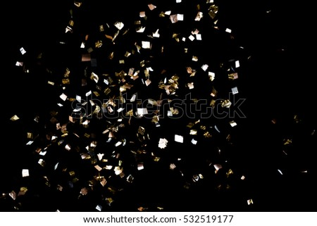 Golden confetti isolated on black background #532519177