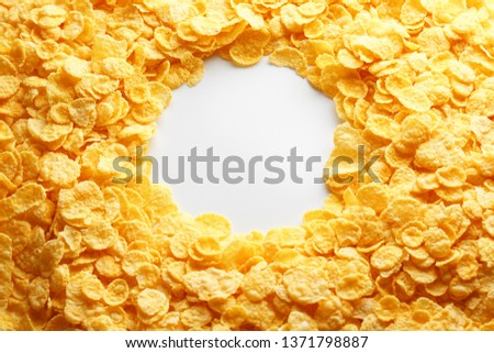 Golden Cornflakes full frame with empty round copy space in the middle as viewed from above. View from above. #1371798887