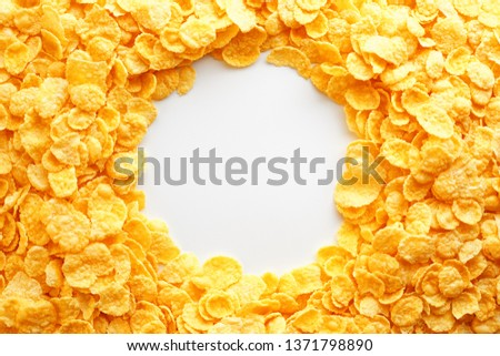 Golden Cornflakes full frame with empty round copy space in the middle as viewed from above. View from above. #1371798890
