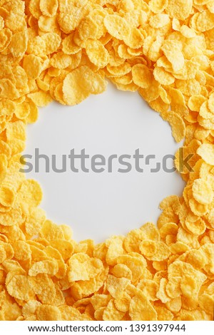Golden cornflakes on full frame with empty white space. Healthy breakfast #1391397944