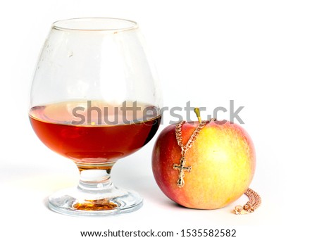golden cross on a chain, a glass with alcohol and a ripe apple #1535582582