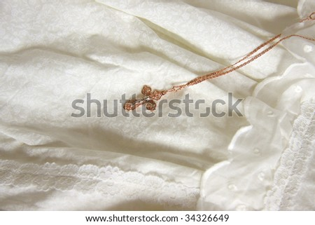 Golden cross on christening dress