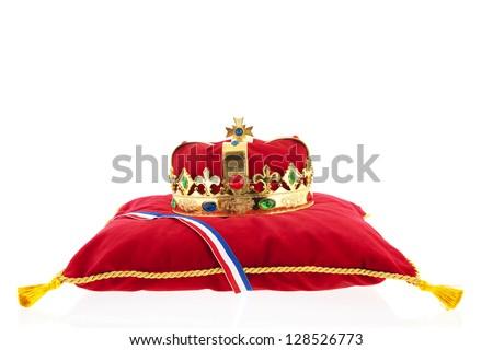 Golden crown on red velvet pillow for coronation in Holland - stock photo