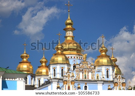 Golden cupolas with crosses of St. Michael's Cathedralin Kiev , Ukraine
