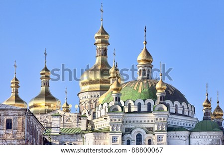 Golden cupolas with crosses of the Assumption cathedral in Kiev Pechersk Lavra Orthodox monastery, Kiev, Ukraine
