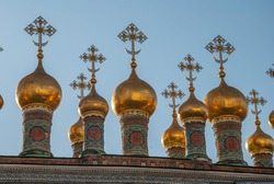 Golden cupolas with the crosses on the Russian Orthodox Church in Moscow