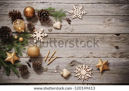 Golden decoration on old wooden background