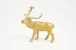 Golden deer figure   model isolated on white background