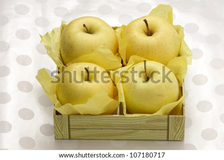 Golden delicious apples  box isolated on white background - stock photo
