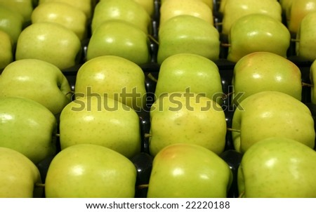 Golden Delicious Apples on tray - stock photo
