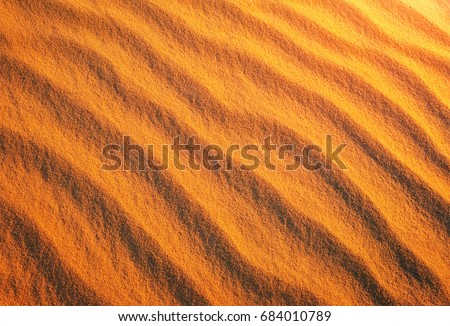 Stock Photo Golden desert sand during sunset as background