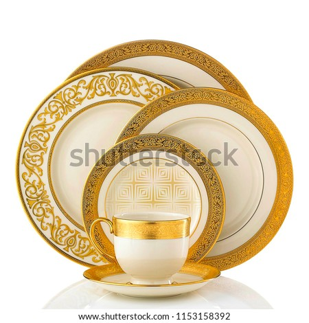 Golden dinner set, Cookware set on white background, Golden dishware set, Golden teacup set