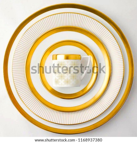 Golden dinner set, Cookware set on white background, Golden dishware set, Golden teacup set, top view