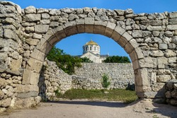 Golden dome of Vladimir's Cathedral as it looks through the street arch in antique city Chersonesus, Sevastopol, Crimea