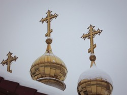 Golden domes with crosses in winter