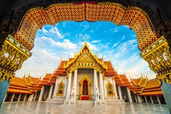 Golden door of Marble buddhist Bangkok Wat Benchamabophit temple evening sunset sky with cloud, Thailand