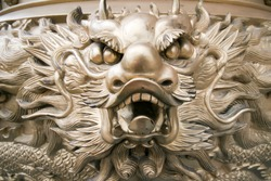 Golden dragon at chinese temple in Thailand