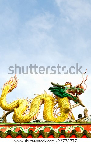 Golden dragon on the chinese temple with blue sky