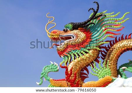 Golden dragon statue. - stock photo