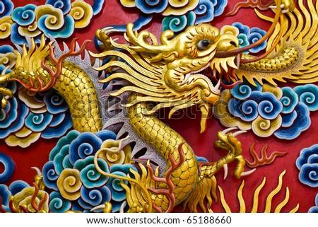 Golden dragon statue in chinese temple in Chonburi province Thailand