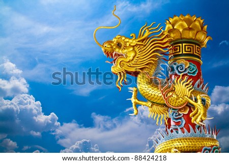 Golden dragon statue on blue sky