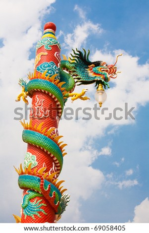Golden dragon statue on red pillar