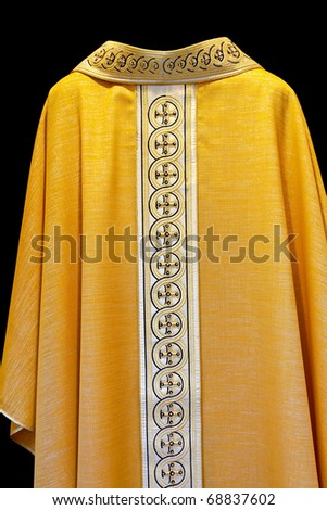 Golden dress for Catholic priest with cross pattern