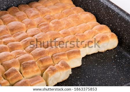 Golden ducat leavened baked buns, dessert or lunch theme. Sweet food.  Photo stock ©