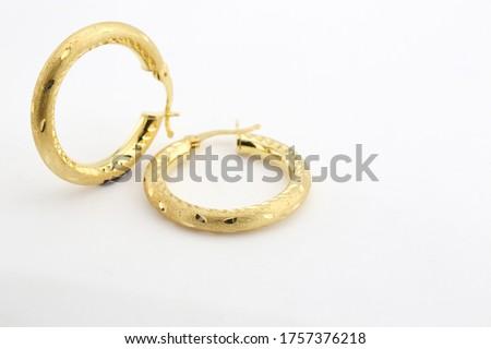 golden earrings isolated on white background Foto stock ©