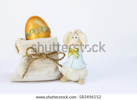 Golden Easter egg and wooden Easter bunny on white background #583496152