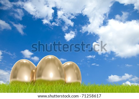 Golden easter eggs in front of a cloudy sky with COPYSPACE