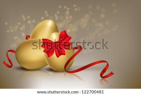 Golden Easter eggs with red bow isolated on background