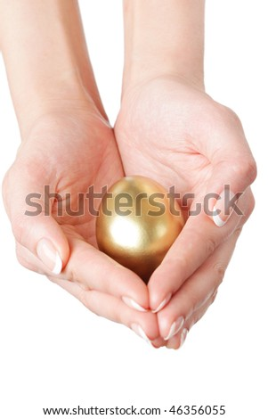 golden egg in the hands