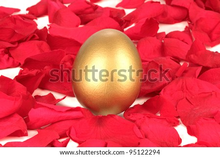 Golden egg on a bed of rose petals