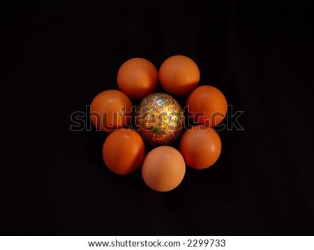 Golden egg with half dozen organic eggs.