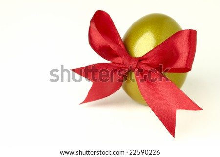 golden egg with red ribbon