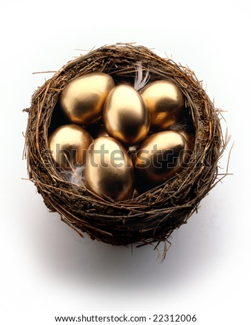 Golden eggs in a nest on white background