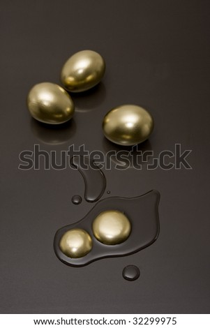 Golden eggs with a reflection on a black background