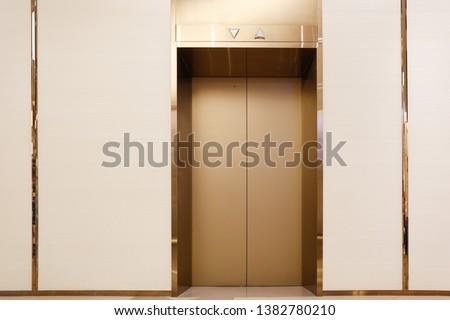 Golden elevators in commercial buildings  #1382780210