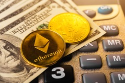 Golden ether coins or Ethereum network exchange on calculator and 100 dollars, blockchain and money cryptocurrency (crypto currency) concept