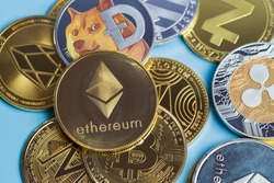 Golden Ethereum ETH group included with Crypto currency coin Dogecoin DOGE, bitcoin BTC, Binance Coin, Zcash TRON symbol Virtual blockchain technology future is money close up and Macro concept.