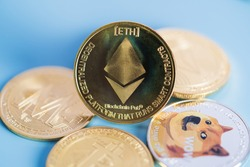 Golden Ethereum ETH group included with Cryptocurrency coin Dogecoin DOGE, bitcoin BTC, Binance Coin, Zcash TRON symbol Virtual blockchain technology future is money close up and Macro concept.