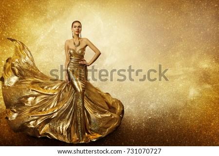 Golden Fashion Model, Elegant Woman Flying Gold Dress, Waving Sparkling Gown Fabric