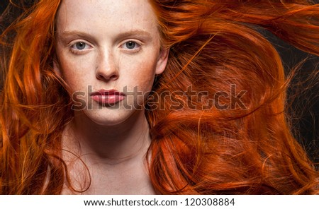 Golden Fashion woman Portrait.Wavy Red Hair. Black Background - stock photo