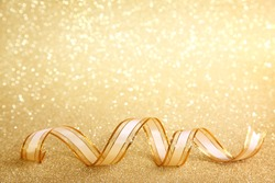 Golden festive background with ribbon