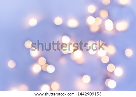 Golden festive bokeh lights on blue background. Christmas or party concept. #1442909153