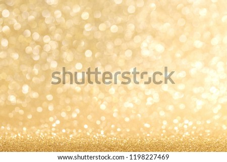 Golden festive glitter background with defocused lights #1198227469