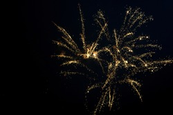 Golden fireworks in the sky. Festive golden exploding pyrotechnics
