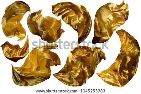 Golden Flying Fabric, Flowing Waving Gold Cloth, Shine Yellow Clothes Drapes Piece, Isolated on White Background